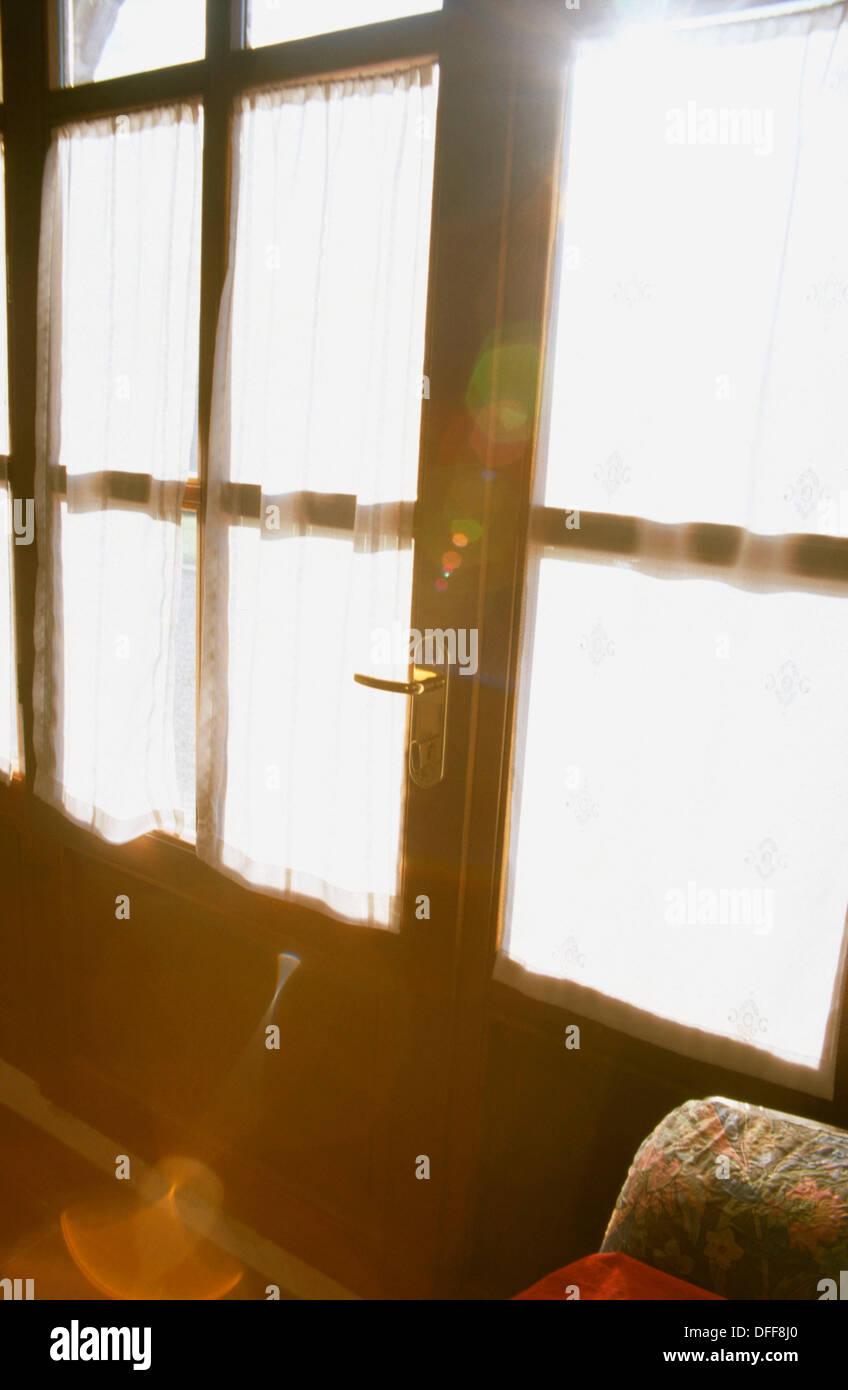 Sunlight through the glass door - Stock Image