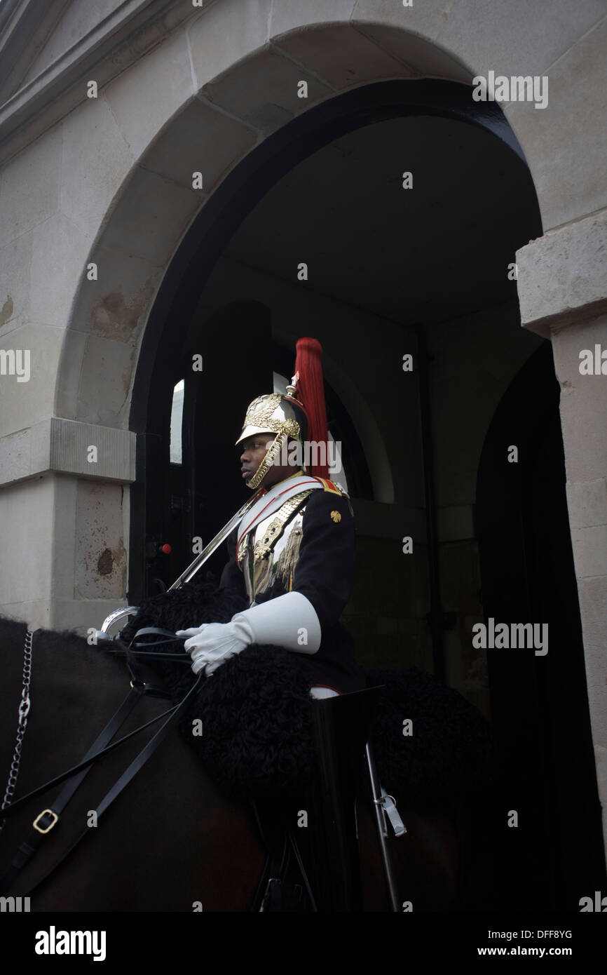 A black mounted lifeguard trooper parades at Horseguards in Whitehall, Westminster, Central London. This regiment Stock Photo