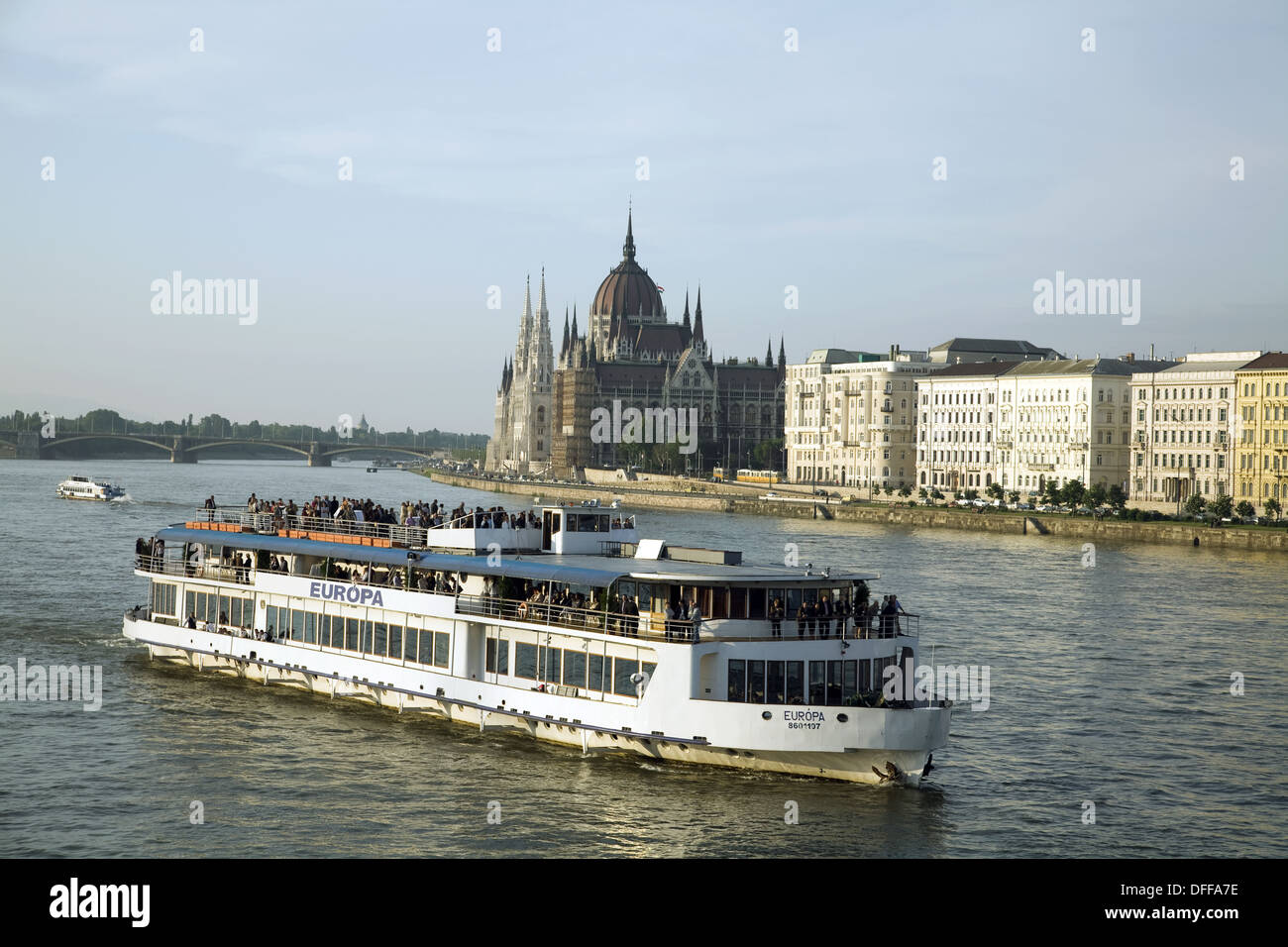 Passenger boat sailing down the Danube River with the