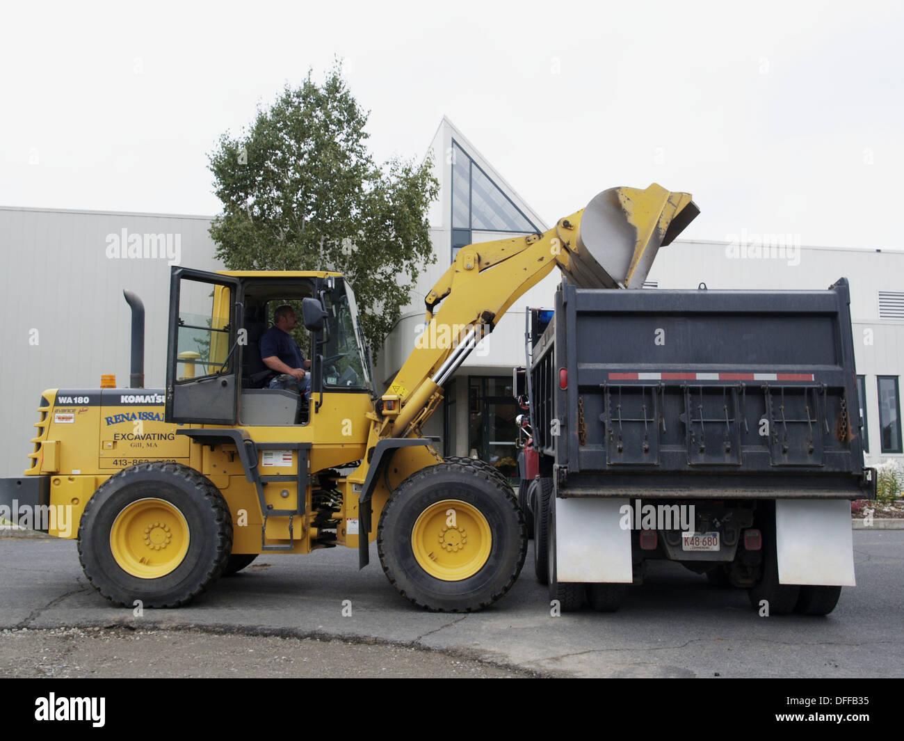 Dump Truck And Front End Loader Removing Asphalt In