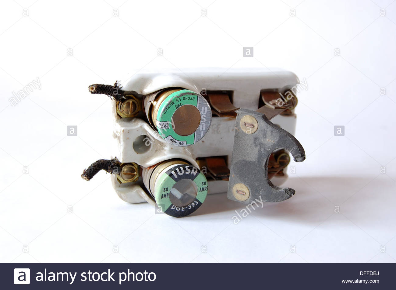 1950s vintage ceramic fuse box electrical circuit breaker with fuses ceramic fuse blocks 1950s vintage ceramic fuse box electrical circuit breaker with fuses and knife switch plain background natural light closeup