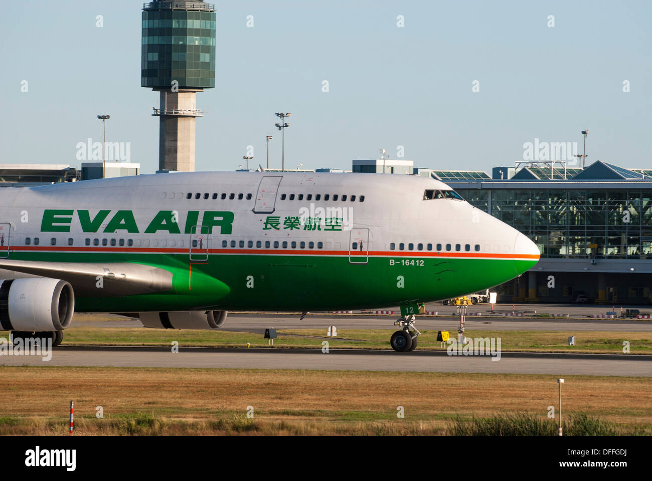 Eva Airlines Wide Body Boeing 747 45E taxiing at Vancouver International Airport - Stock Image