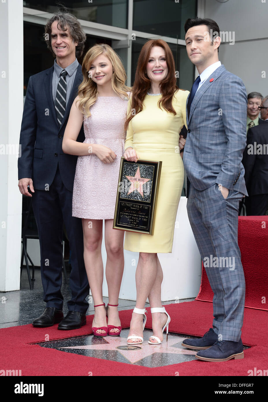 Hollywood Walk of Fame, Los Angeles, USA . 03rd Oct, 2013. Julianne Moore (yellow) pictured with Jay Roach, Chloe Grace Moretz and Joseph Gordon Levitt as she was honored with a star on the Hollywood Walk of Fame, Hollywood, USA. Oct 3rd 2013 Credit:  Sydney Alford/Alamy Live News - Stock Image