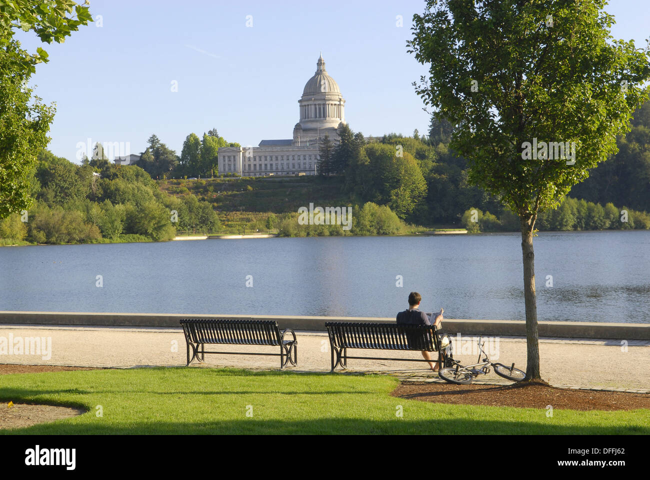 Visitor Rests On Park Bench At Capitol Lake View Of
