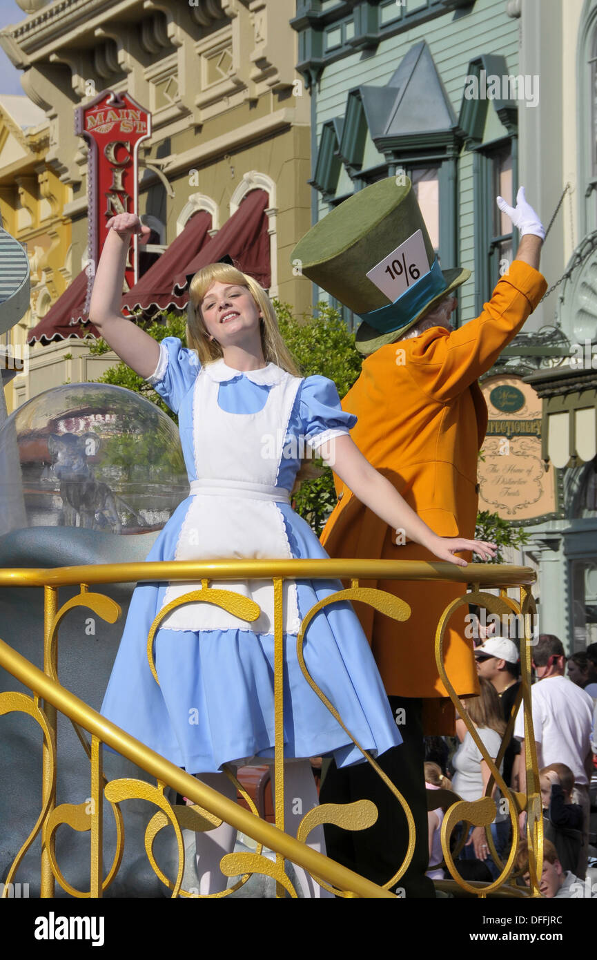 Alice in Wonderland in Parade at Walt Disney Magic Kingdom Theme Park Orlando Florida Central - Stock Image