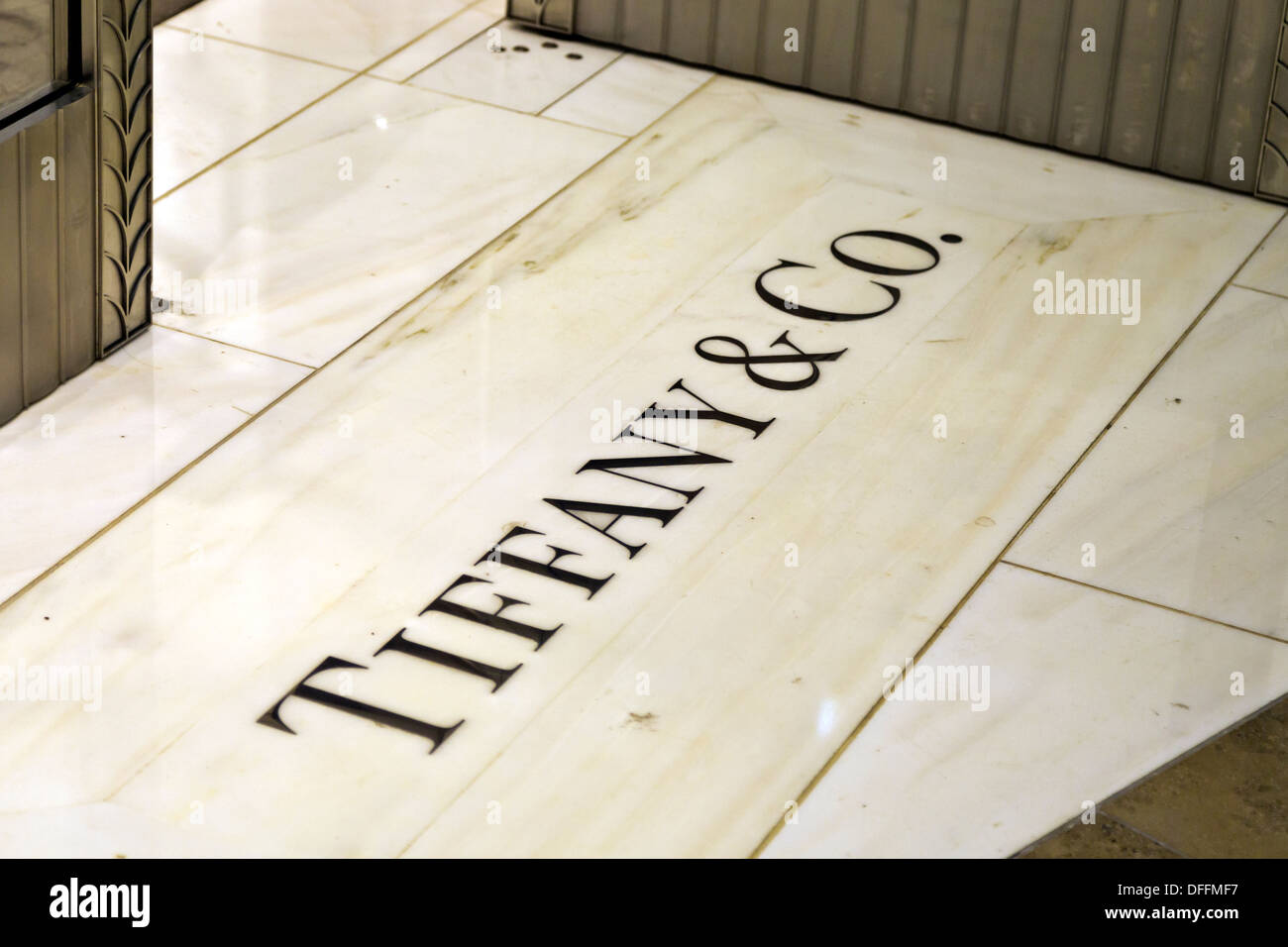 Tiffany & Co. engraving on tile flooring in front of store ...