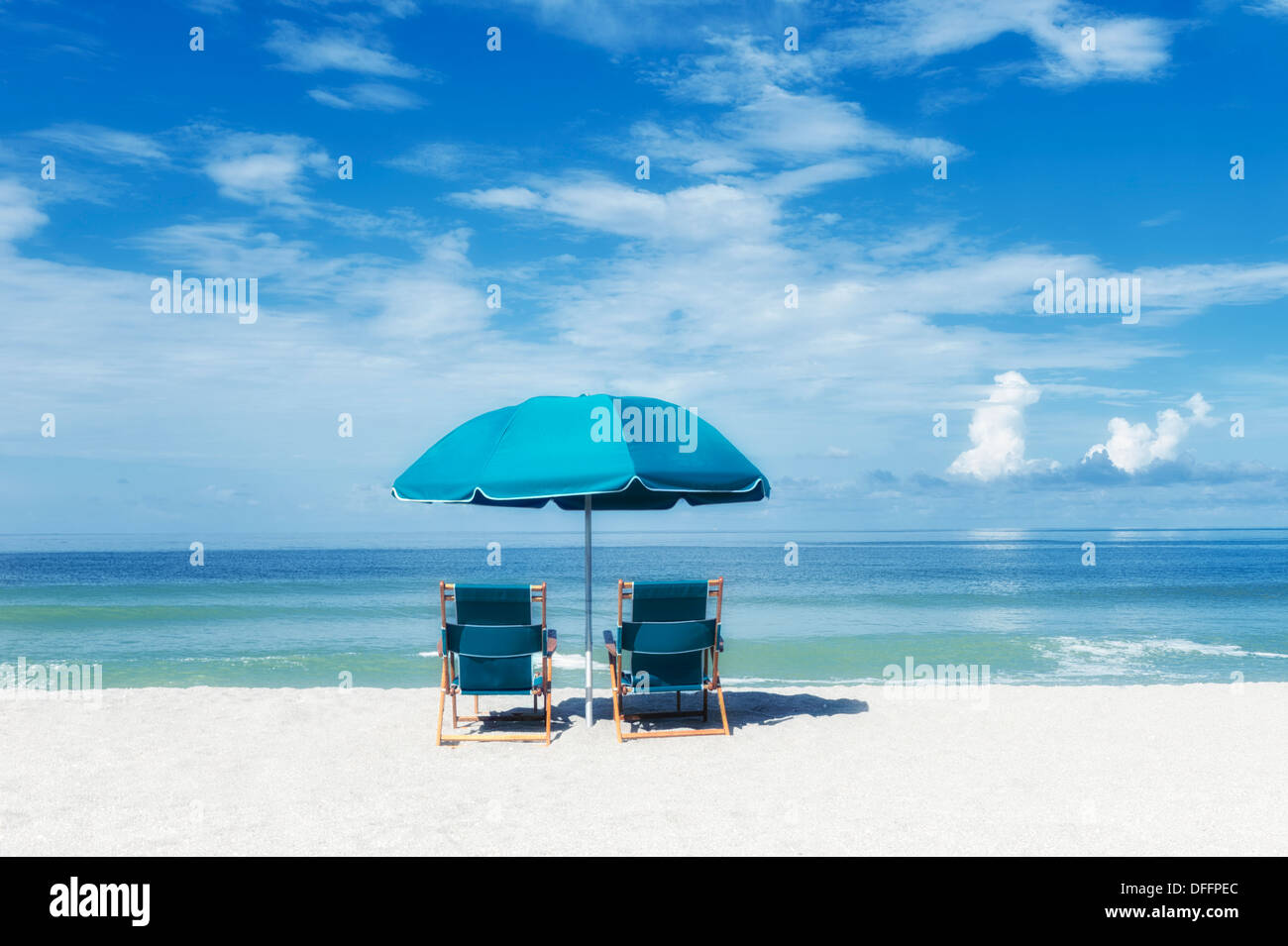 Two turquoise beach chairs under umbrella facing the ocean sea shore under sunny warm blue sky blue-green ocean & Two turquoise beach chairs under umbrella facing the ocean sea shore ...