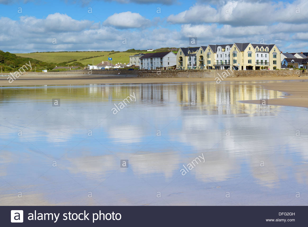 Clouds reflected in the wet sand, Broad Haven beach, Pembrokeshire, Wales UK Britain - Stock Image