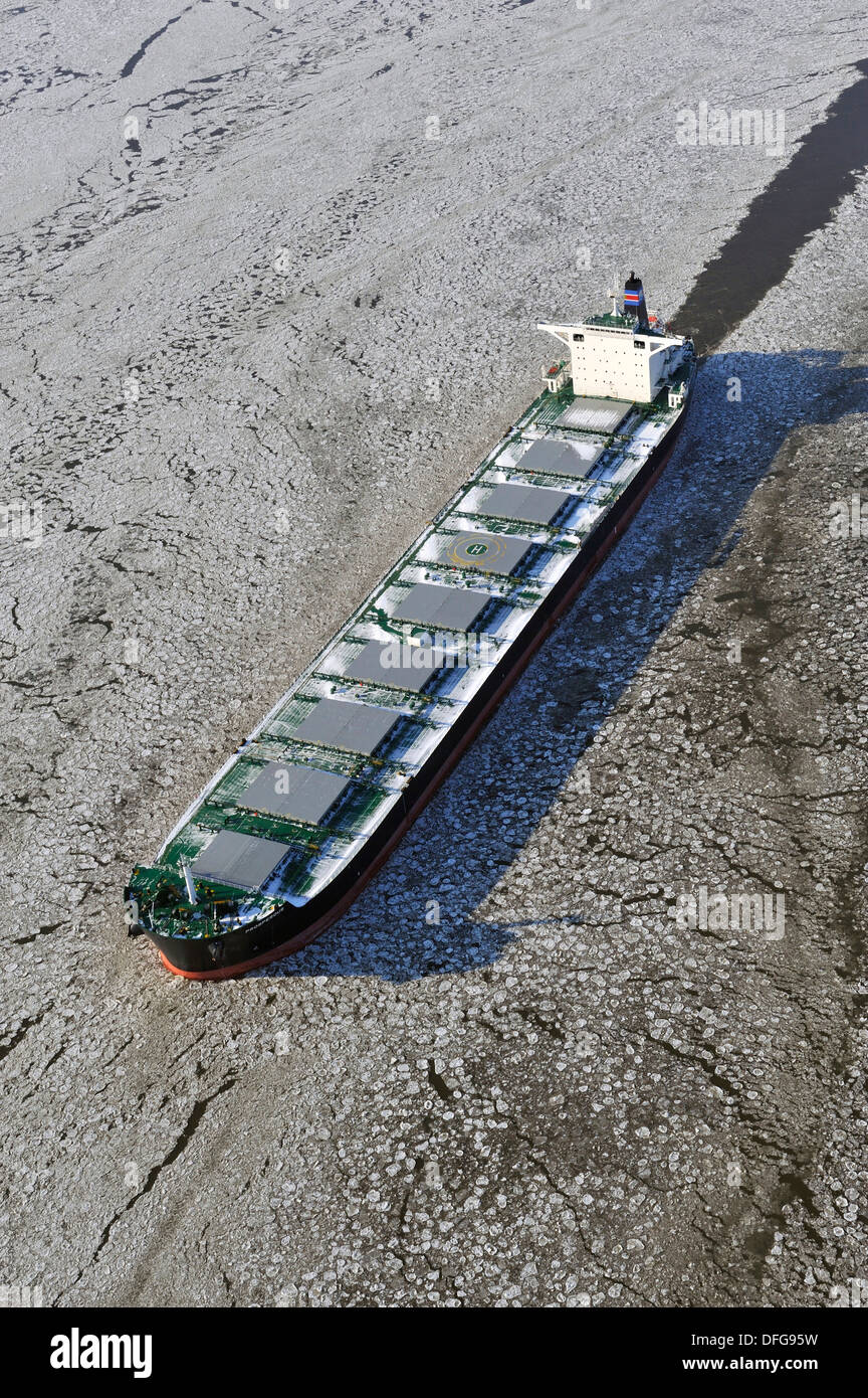 Cargo ship Prosperous on the Elbe River with ice flow, aerial view, Hamburg, Hamburg, Germany - Stock Image