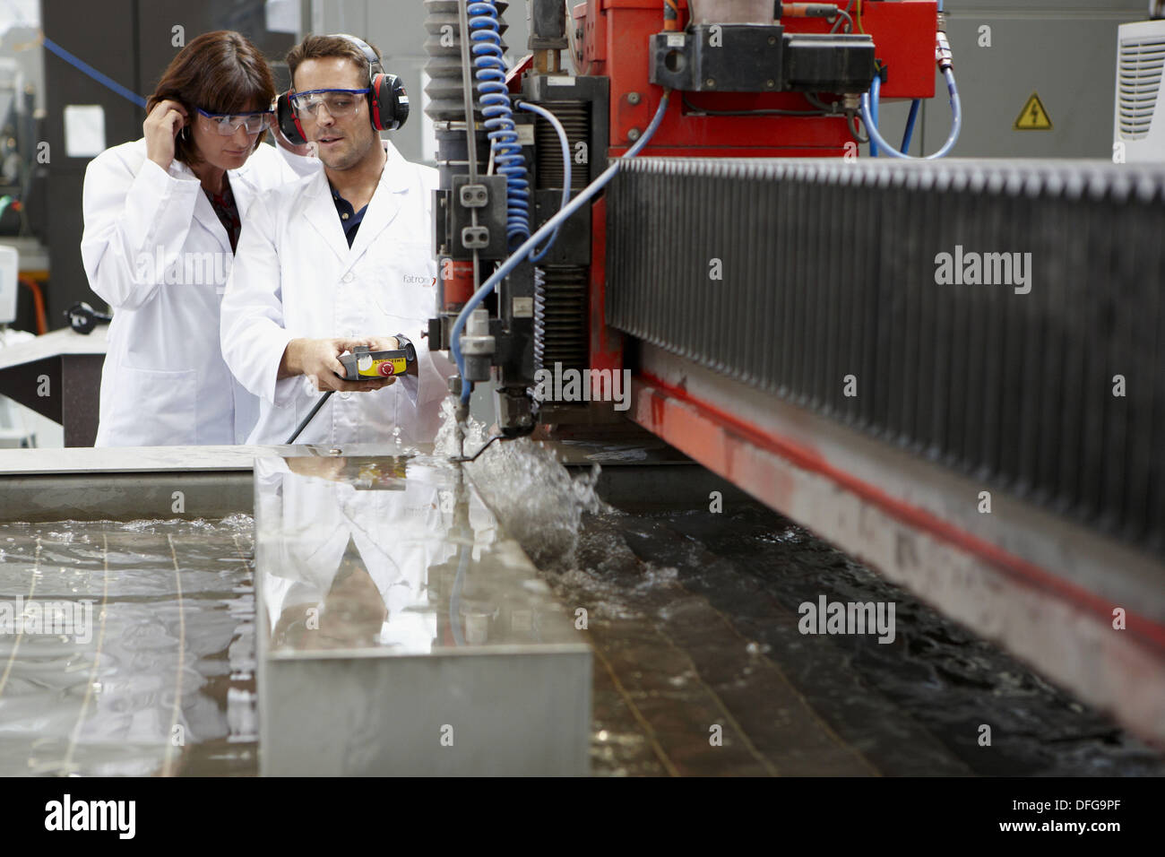 Researchers using abrasive waterjet technology cutting machine for