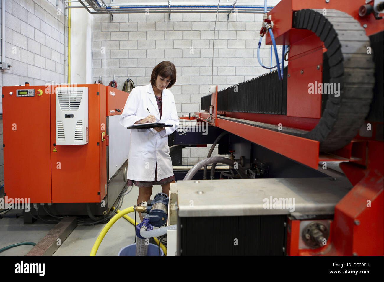 Researcher checking abrasive waterjet technology cutting