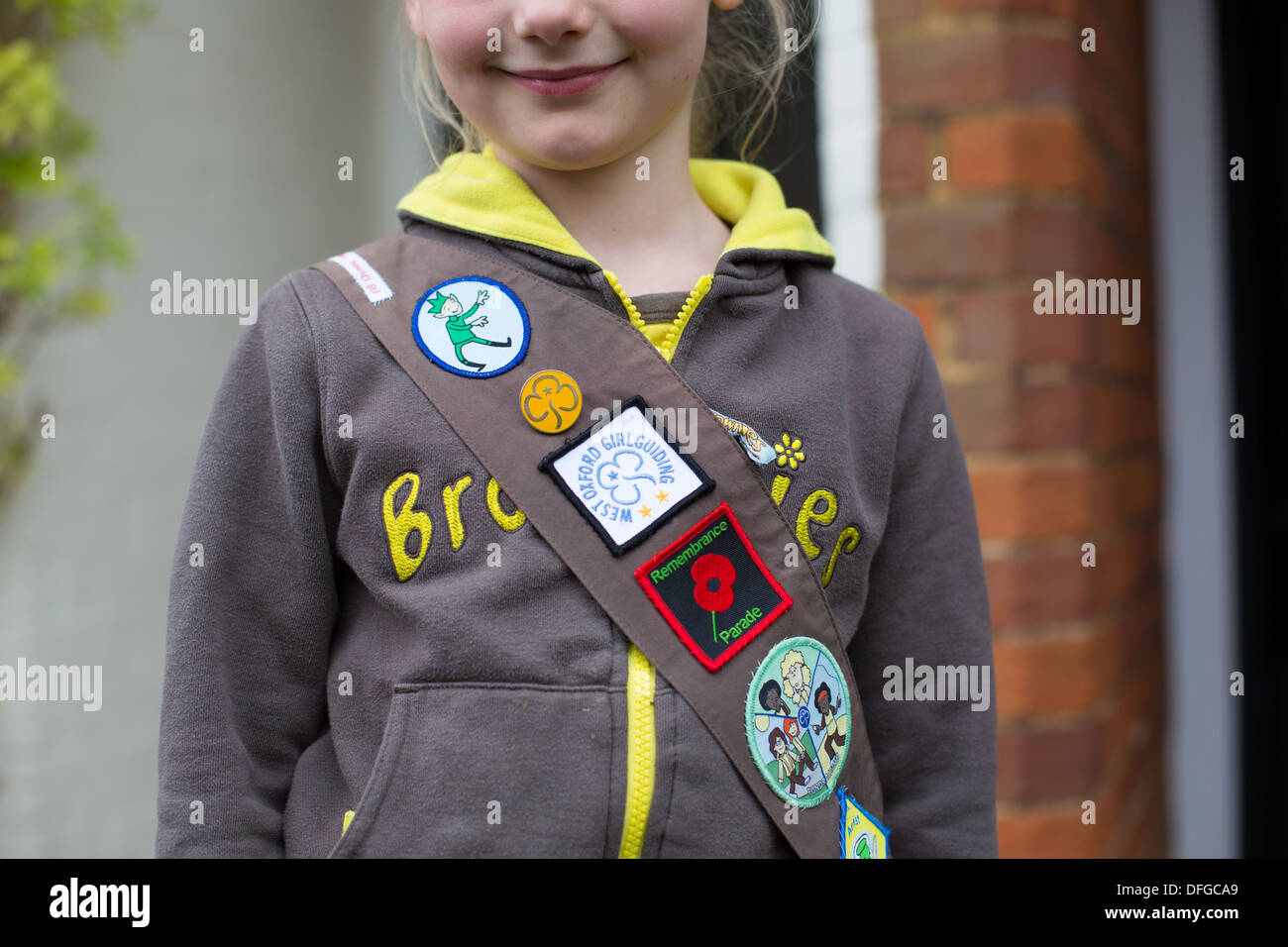 Young Girl wearing Brownie Uniform - Stock Image