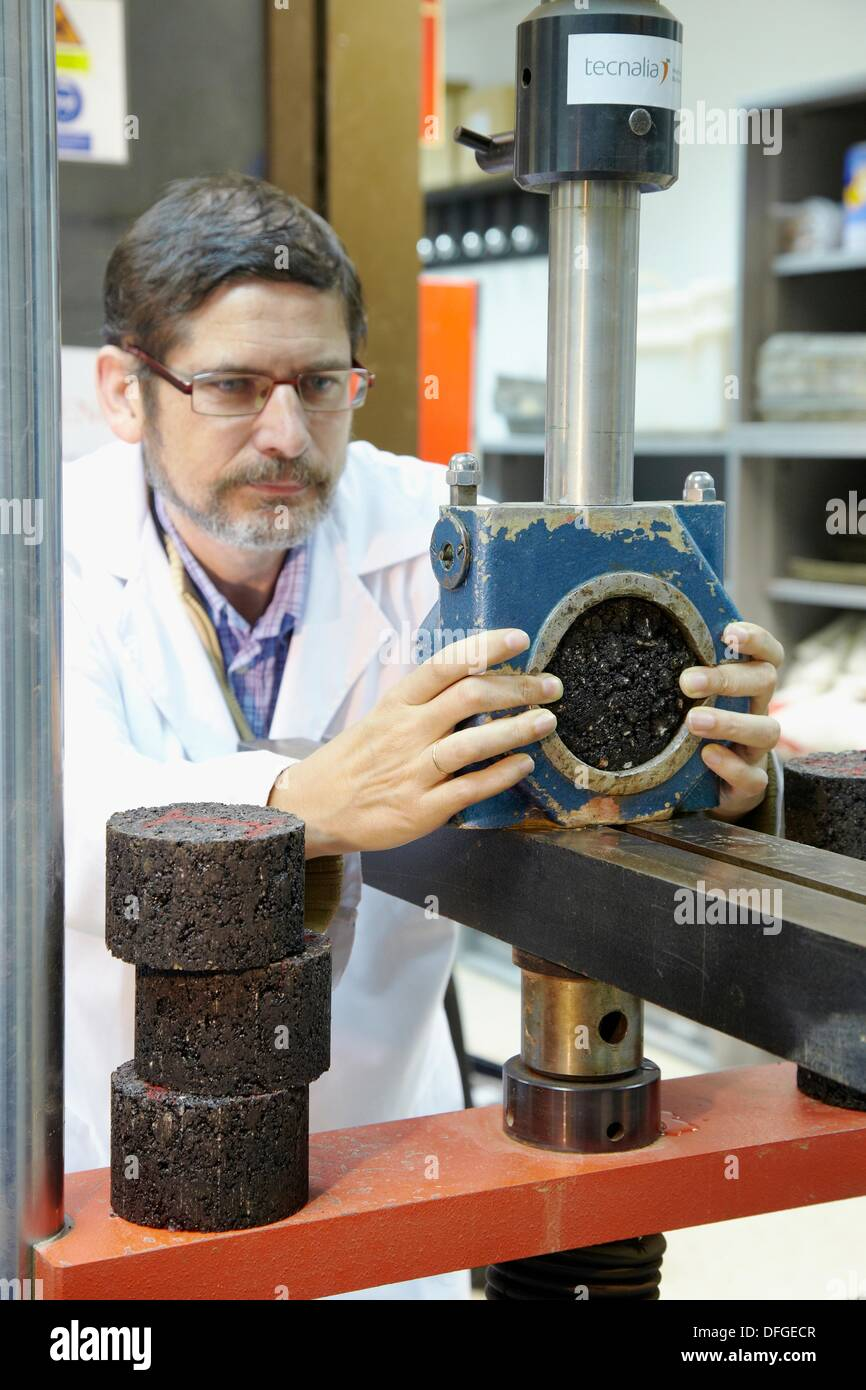 Marshall test, determining the stability and deformation of cylindrical specimens of hot mix asphalt, Research on building - Stock Image