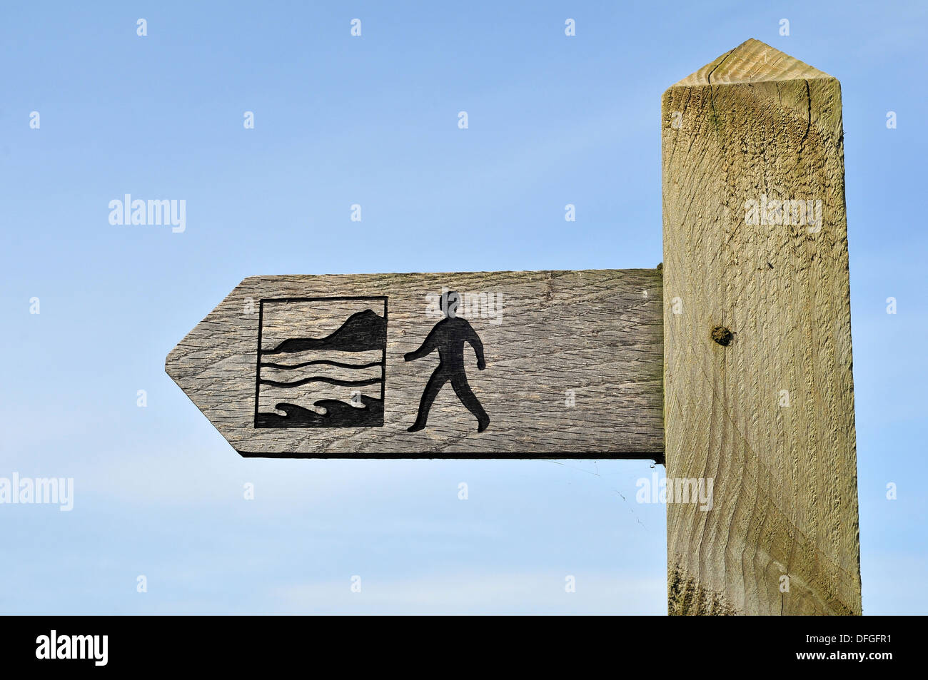 Finger signpost showing the route of the Wales Coast Path near Aberystwyth, Ceredigion, Wales, UK - Stock Image