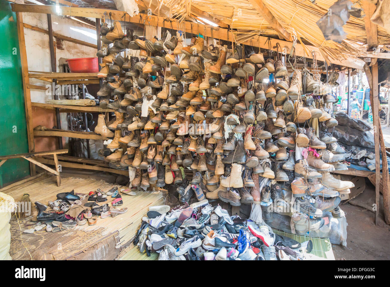 Shoes, trainers, boots and other second hand footwear, for sale in Maramba Market, Livingstone, Zambia - Stock Image