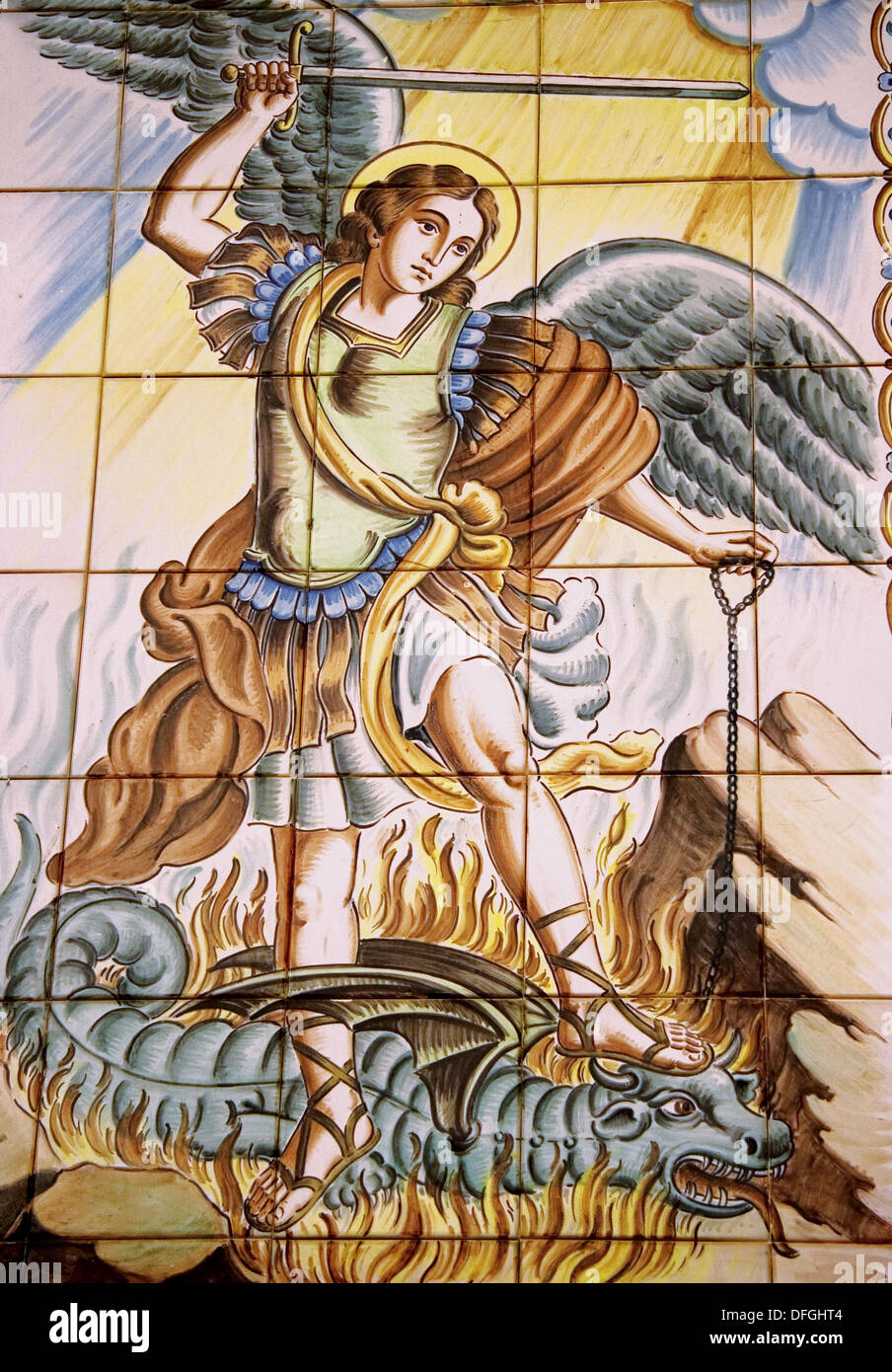 Saint Michael and the Dragon, on painted ceramic tiles at the church of Murla, in the Jalon valley. Alicante province. Spain. - Stock Image