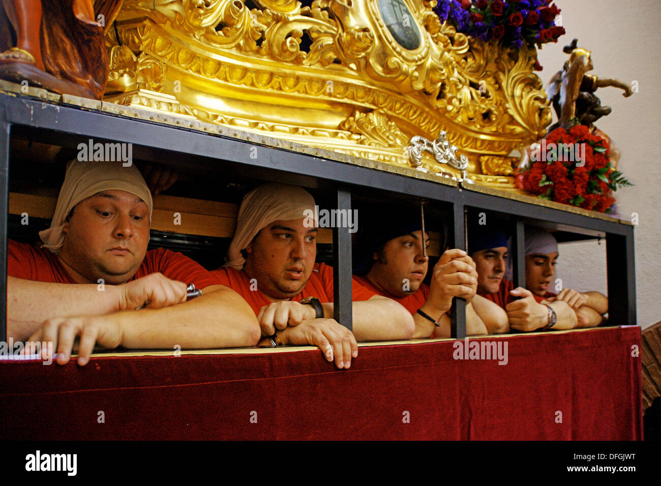 Men bearing float during a Holy Week processione, Ronda, Malaga province, Andalusia, Spain - Stock Image