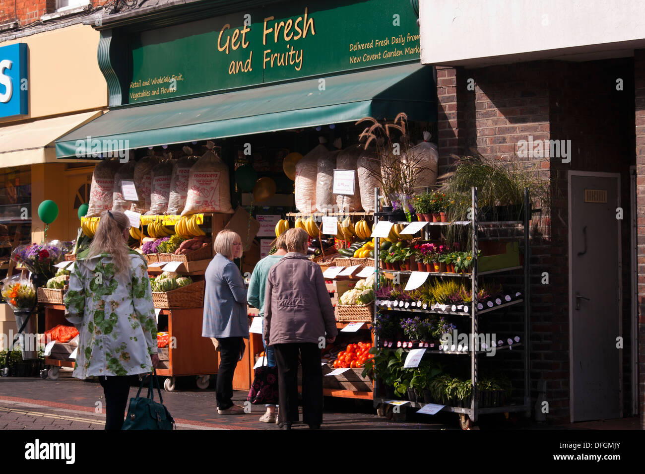 Customers Outside A greengrocers Fruit and Veg Shop Display UK - Stock Image