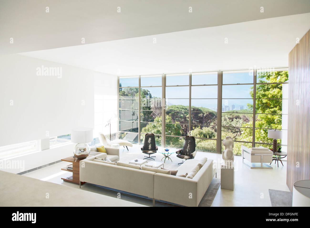 Modern living room overlooking trees Stock Photo: 61219074 - Alamy