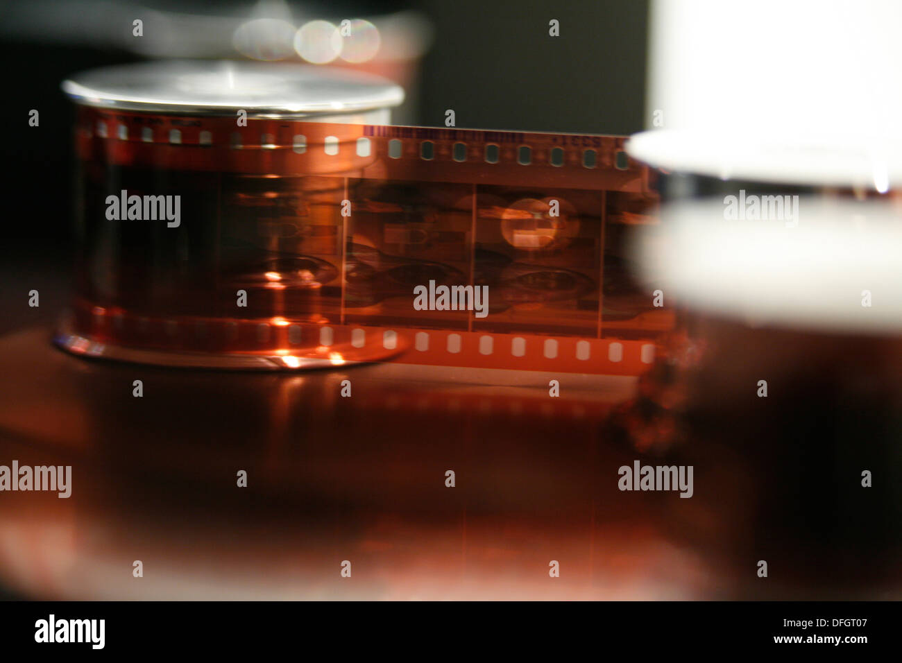 Cine film passing through a TeleCine machine and being transferred to video - Stock Image