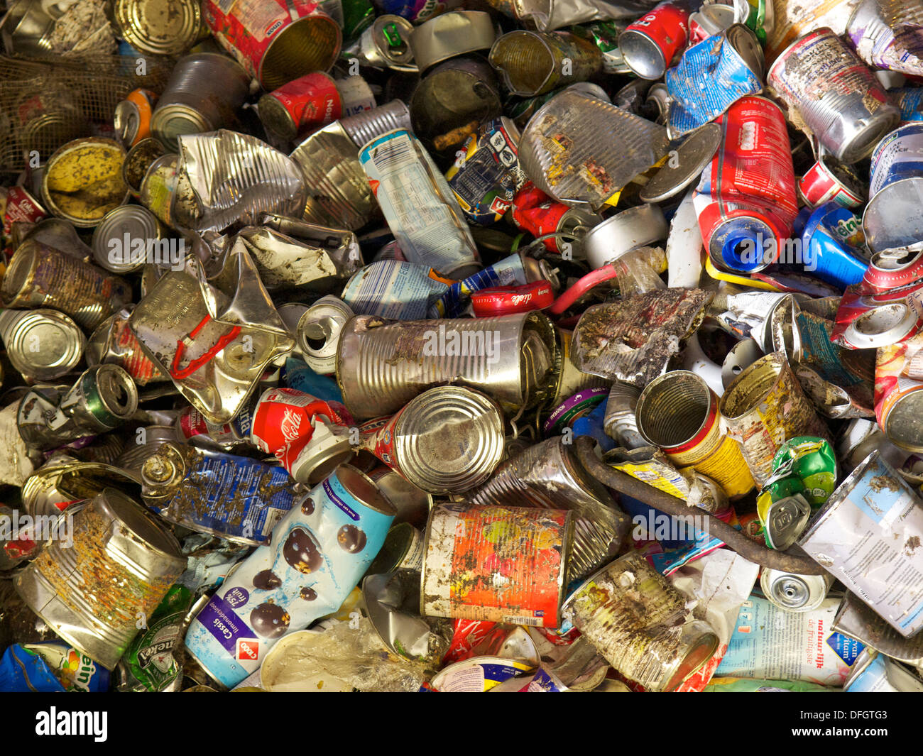 Metal items separated from household waste in recycling plant, ready to be sold and used again. - Stock Image