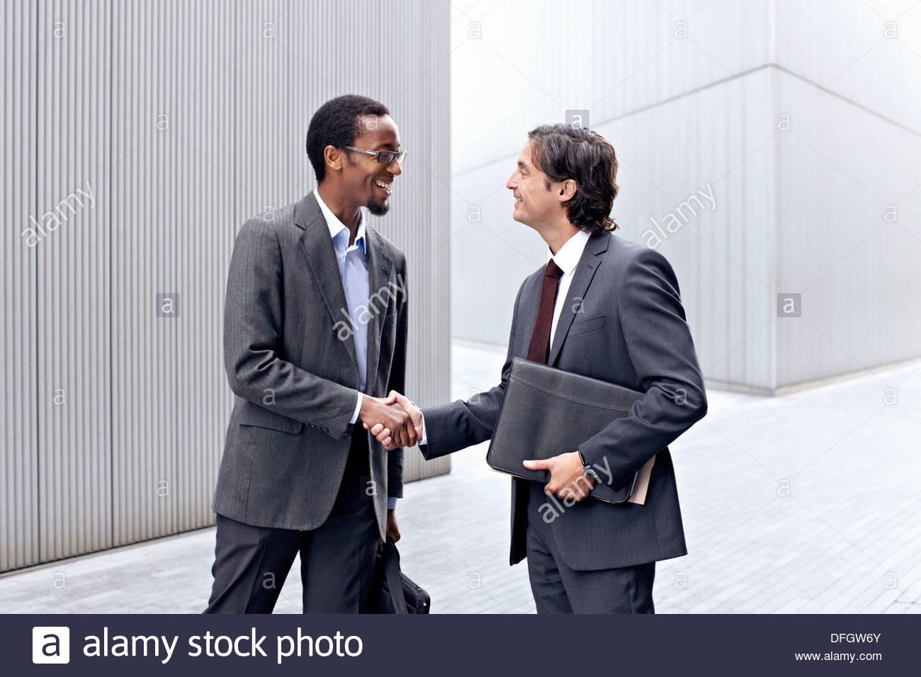 Businessmen handshaking - Stock Image