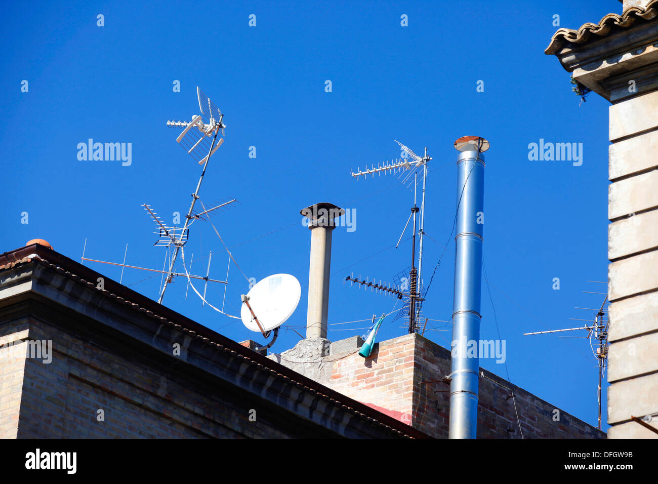 Television aerials on buildings in Vasto, Italy. - Stock Image