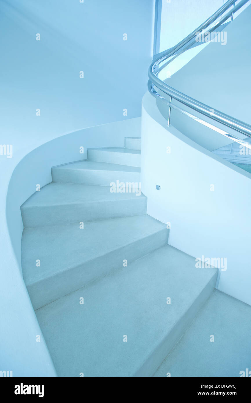 Winding staircase in modern house - Stock Image