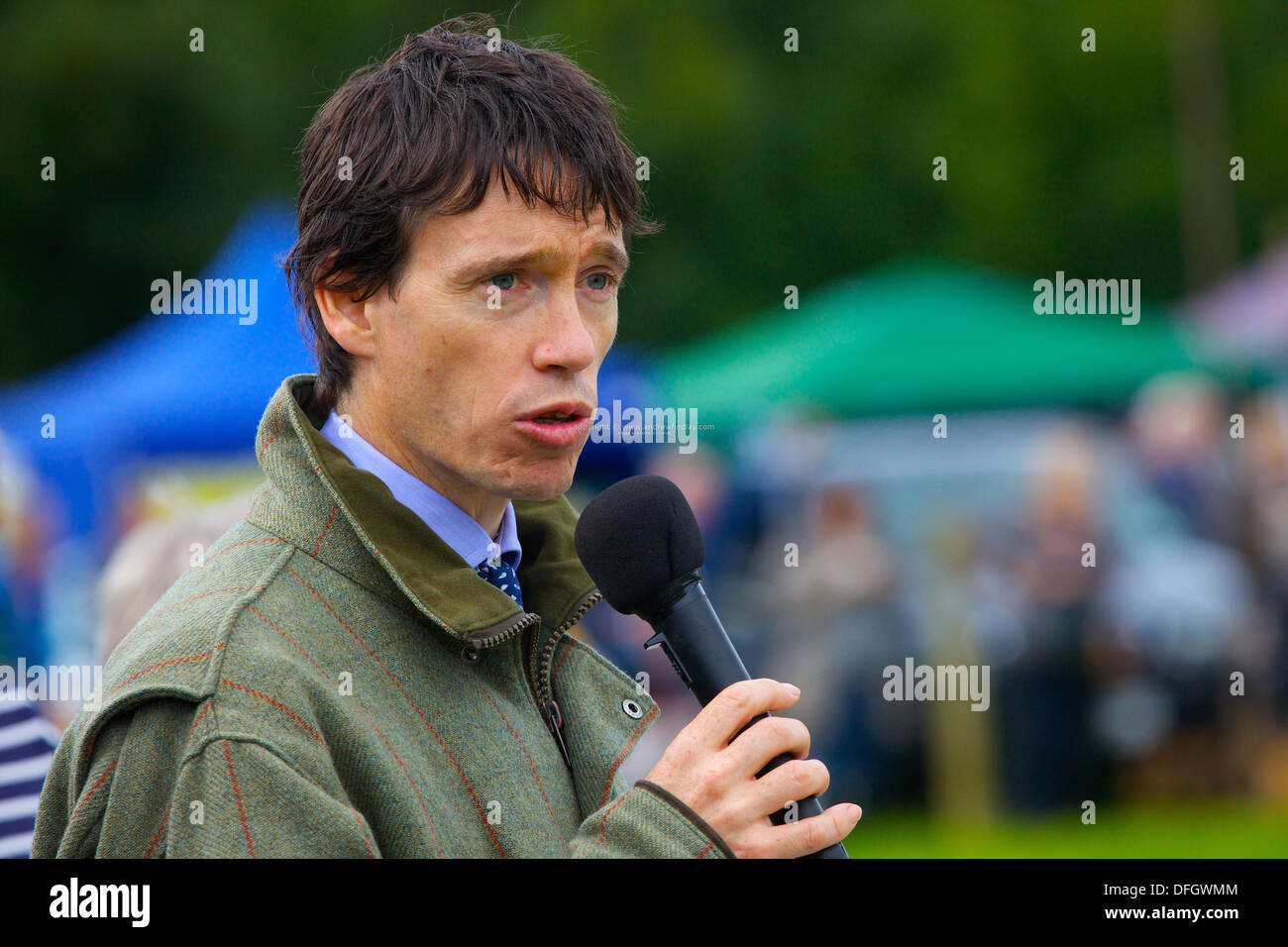 Rory Stewart Conservative Member of Parliament for Penrith and the Border. with a microphone Hesket Newmarket Agricultural Show. - Stock Image