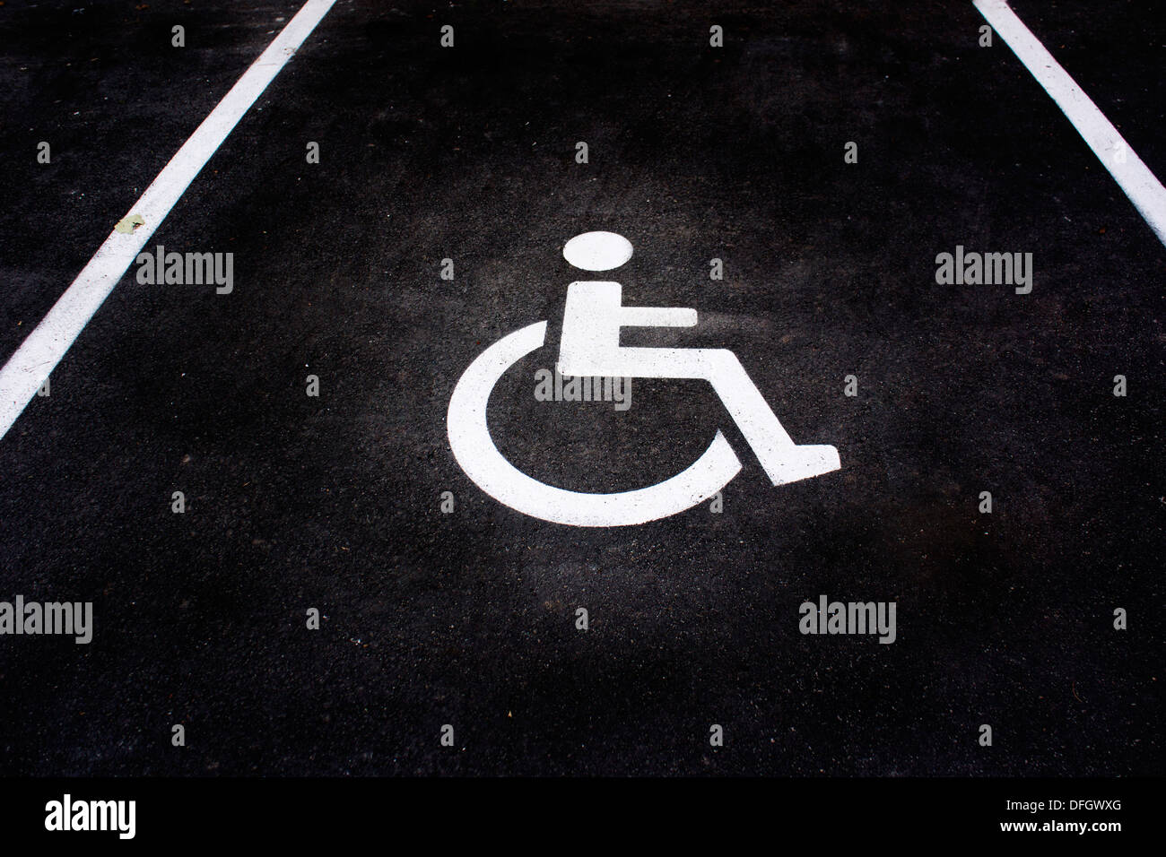 disabled sign on parking space - Stock Image