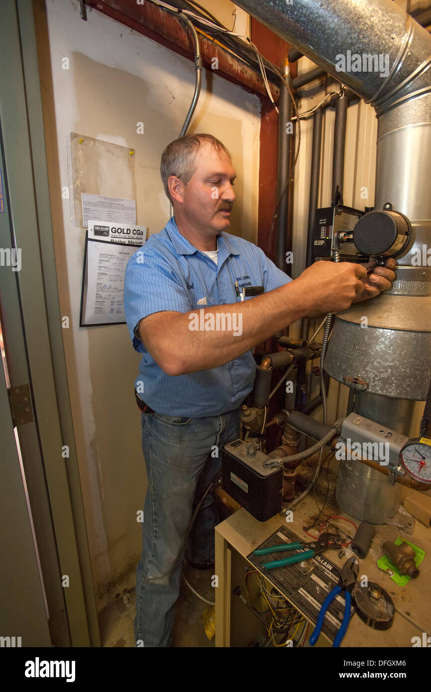 Maintenance Worker at Public School - Stock Image