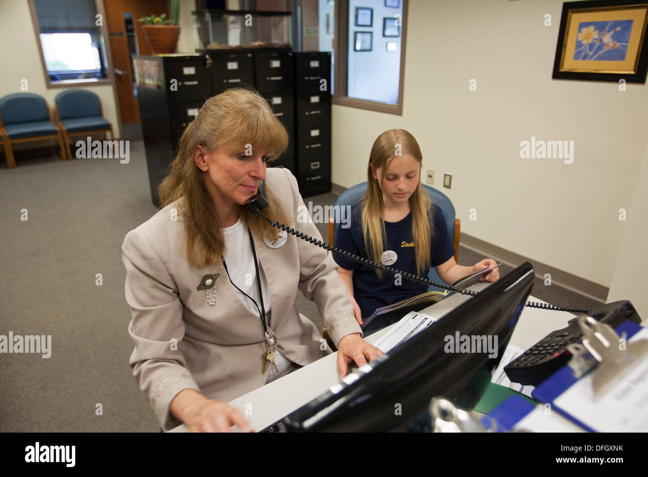 School Secretary at Work with Daughter - Stock Image