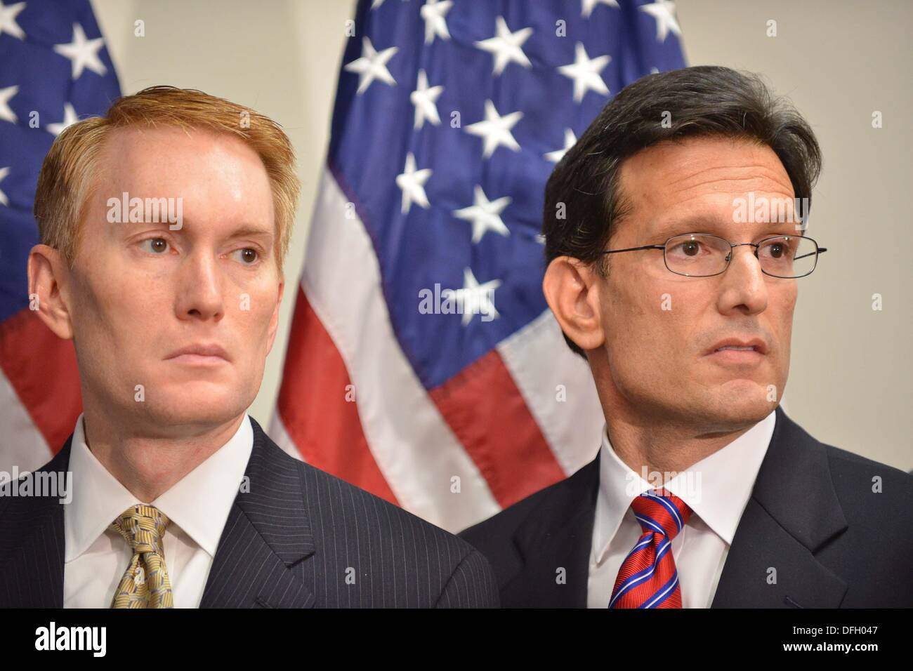 Washington, DC, USA. 4th Oct, 2013. Republican House members James Lankford, Oklahoma, and Majority Leader Eric Cantor, Virginia, listen to House Speaker John Boehner discuss the government shutdown and looming debt ceiling crisis. Credit:  Jay Mallin/ZUMAPRESS.com/Alamy Live News - Stock Image