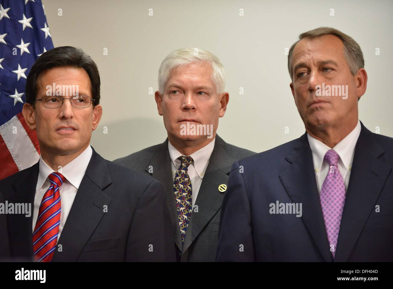 Washington, DC, USA. 4th Oct, 2013. Republican House members Eric Cantor, Virginia, Pete Sessions, Texas, and Speaker John Boehner, Ohio, listen to other party leaders speak on the government shutdown and looming debt ceiling crisis. Credit:  Jay Mallin/ZUMAPRESS.com/Alamy Live News - Stock Image
