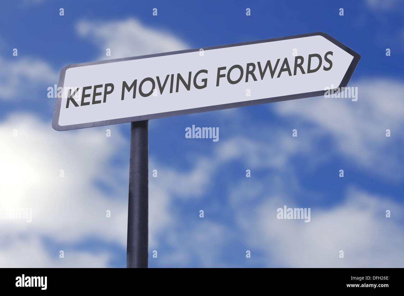 Keep moving motivational street sign - Stock Image