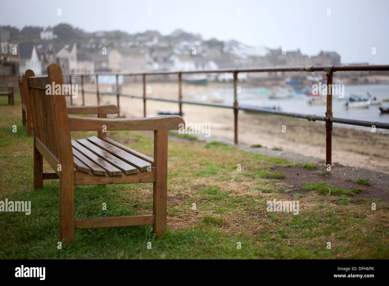 Bench overlooking the harbour, Hugh Town, St Marys, Isles of Scilly, Cornwall - Stock Image