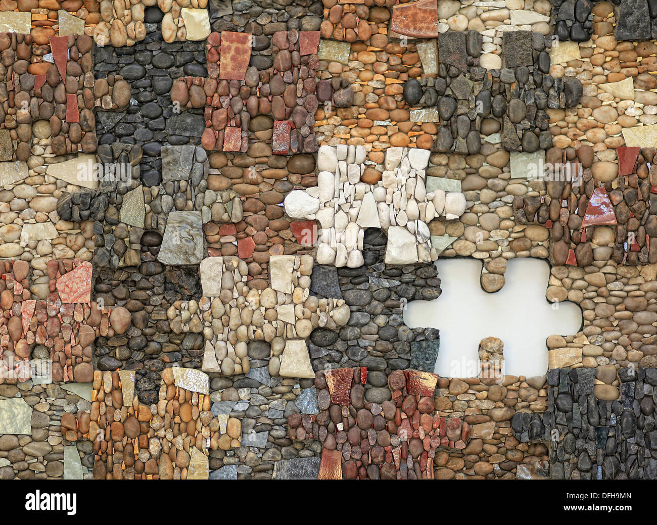 A jigsaw puzzle with missing piece. Mosaic made of materials like stones, pebbles, marble and glass. Scuola Mosaicisti del Friuli, Italy. - Stock Image