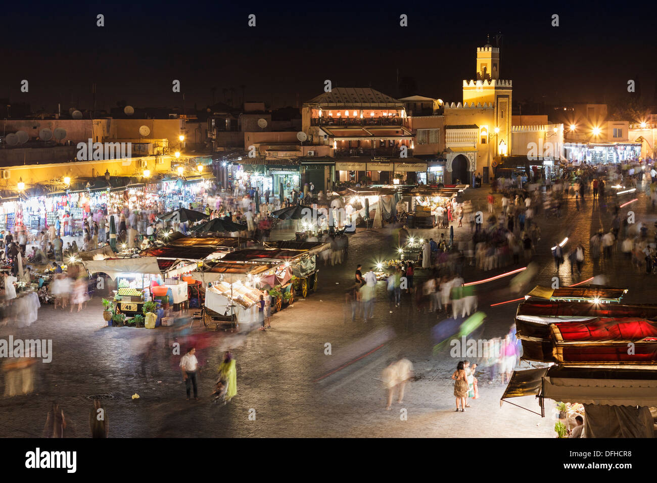 Hustle and bustle at night in Djemaa el Fna square, Marrakesh, Morocco Stock Photo