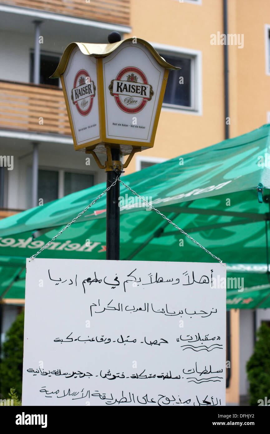 Zell am See caters for tourists from Dubai with signs in Arabic script - Stock Image