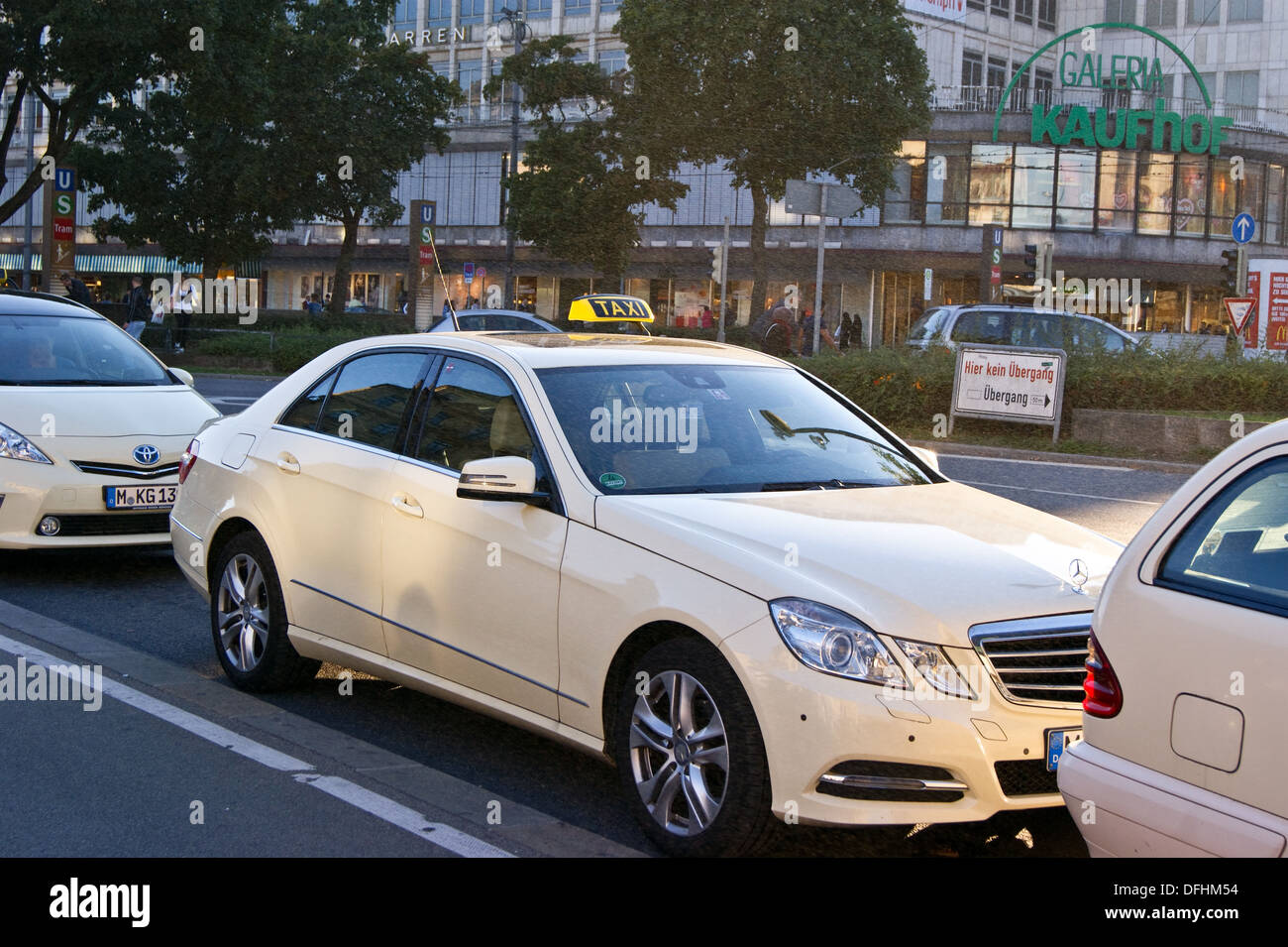 pale yellow mercedes e class taxi waiting at a rank in. Black Bedroom Furniture Sets. Home Design Ideas