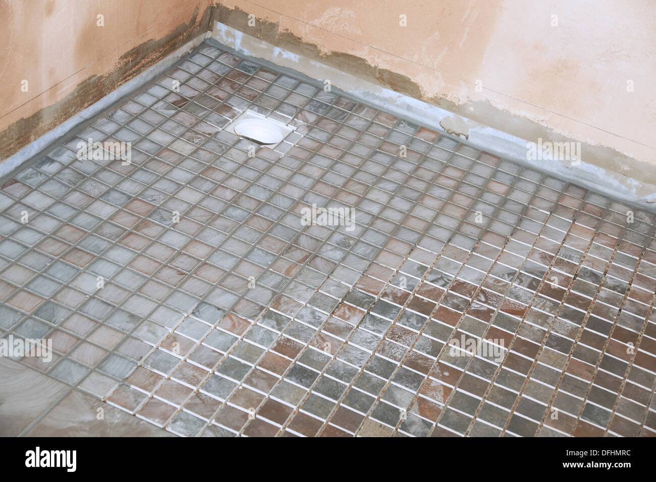 Non slip tiles used for the flooring in a wet room shower bathroom