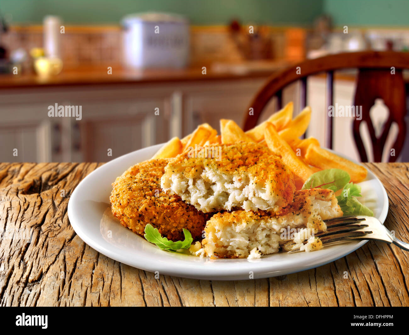 British Food - Breaded Fish Cake & Chips - Stock Image