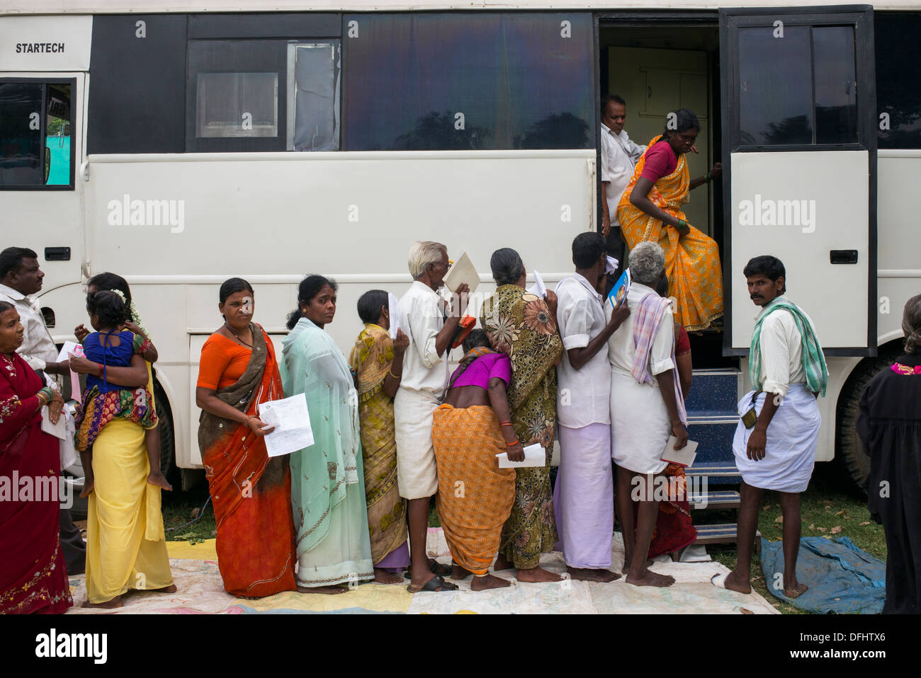Patients queuing for testing in the Sri Sathya Sai Baba mobile Stock