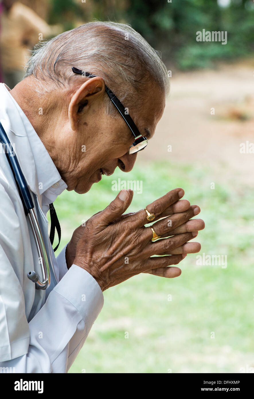 Indian Doctor In Prayer At Sri Sathya Sai Baba Mobile Outreach Stock
