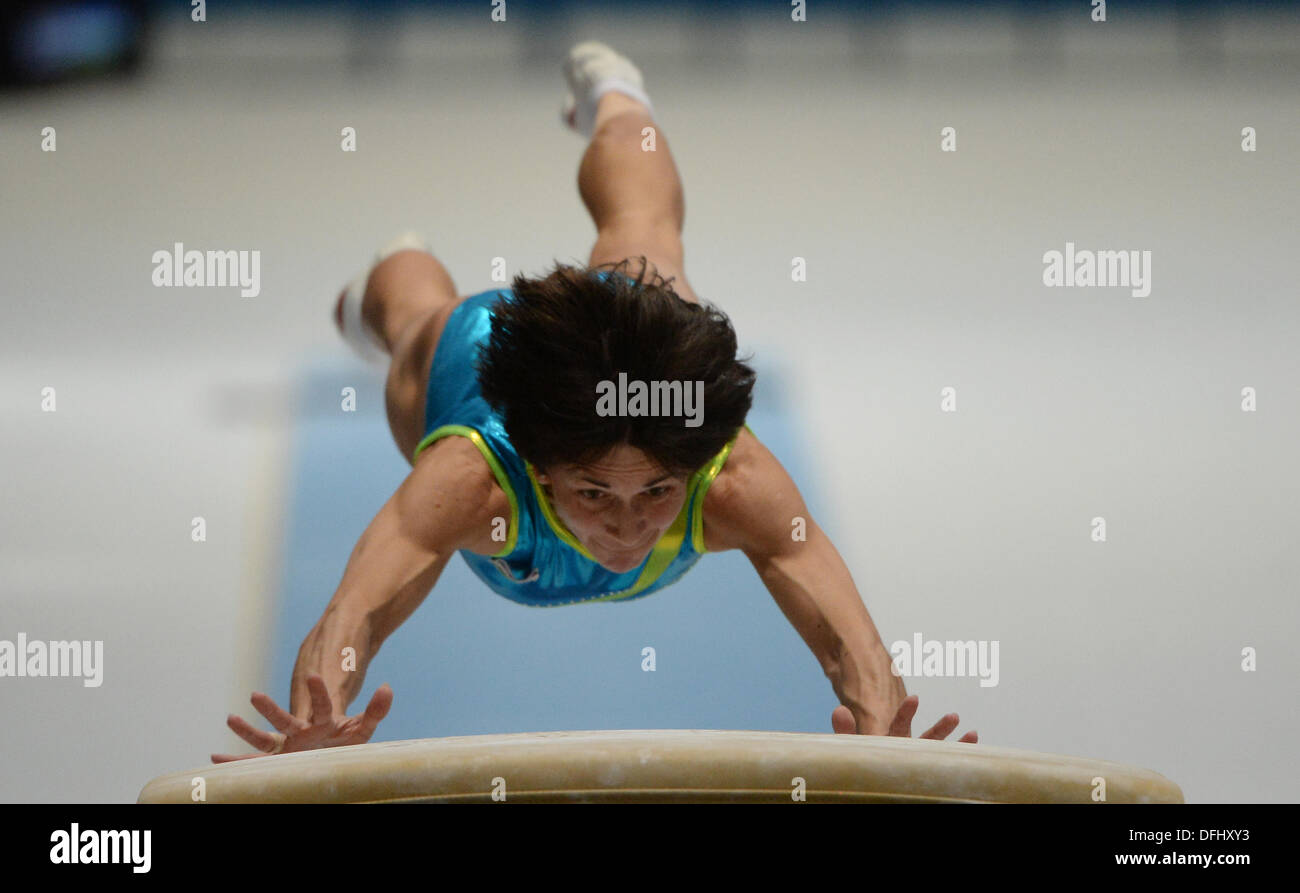 Antwerp, Belgium. 05th Oct, 2013. Oksana Chusovitina of Usbekistan competes at the Vault during the women's Apparatus final at the Artistic Gymnastics World Championships in Antwerp, Belgium, 05 October 2013. Photo: MARIJAN MURAT (For editorial use only)/dpa/Alamy Live News - Stock Image