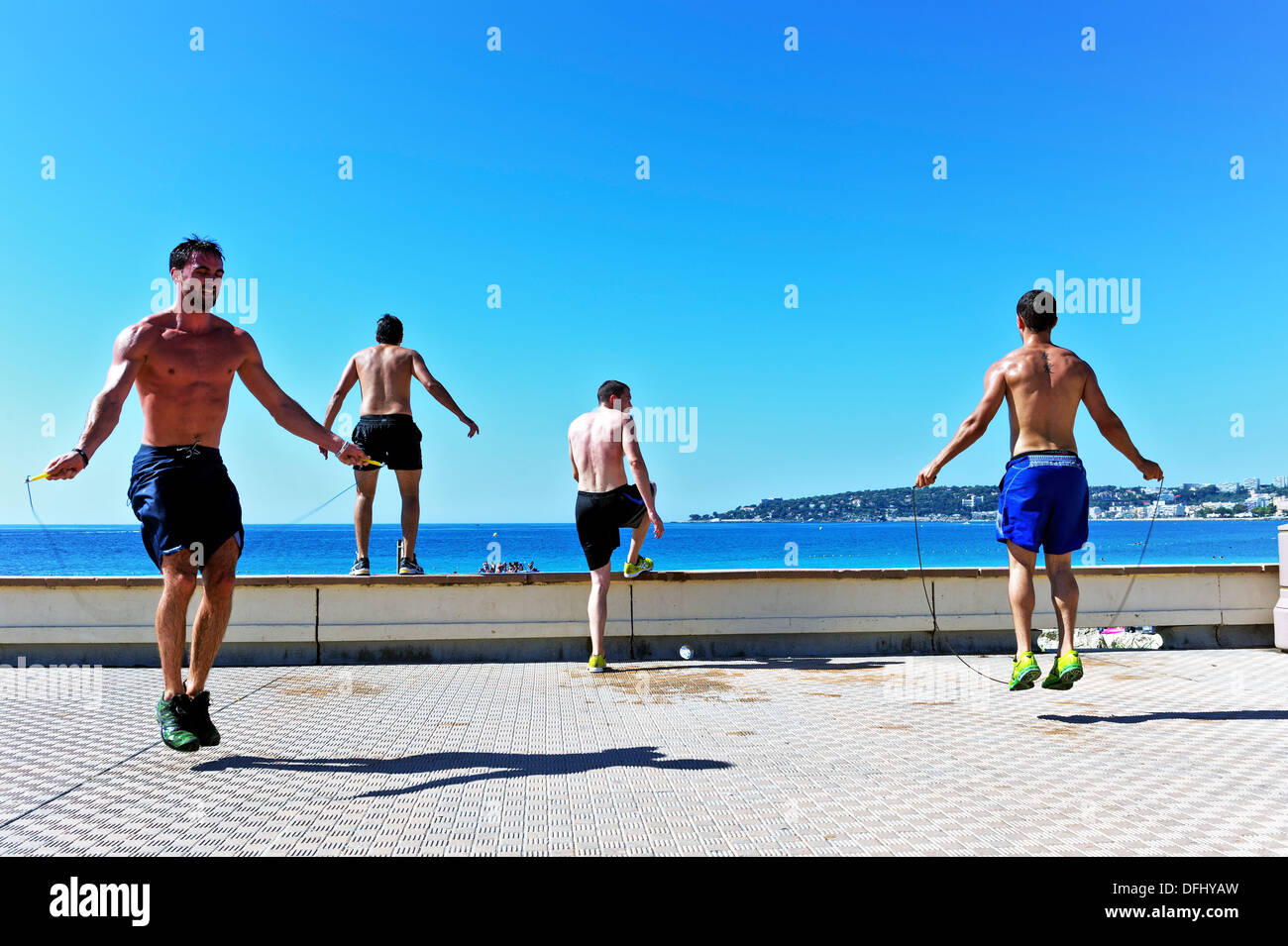 Europe, France, Alpes-Maritimes, Menton. Young athletes men making the jump rope. - Stock Image