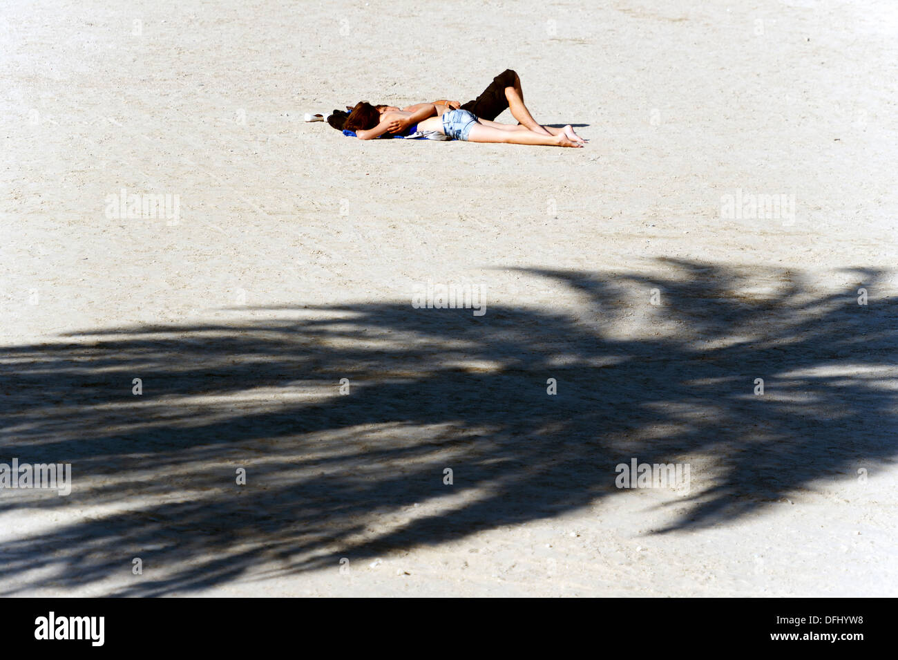 Europe, France, Alpes-Maritimes, Menton. Couple of teenager entwined on the beach. - Stock Image