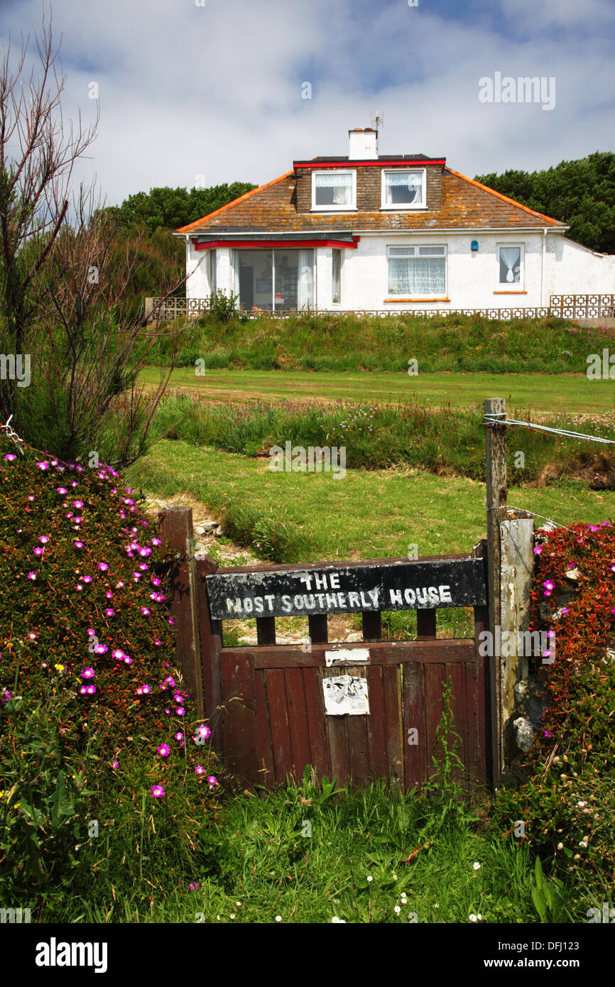 """A bungalow with a notice saying """"The most southerly house"""" (in Britain). Stock Photo"""