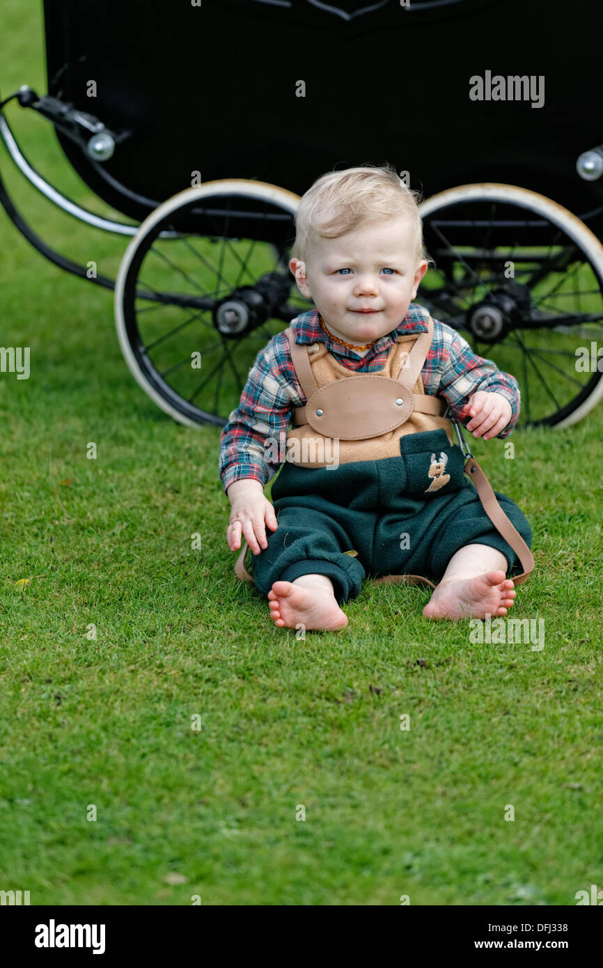 Child In Old Fashioned Leather Harness Sitting By His