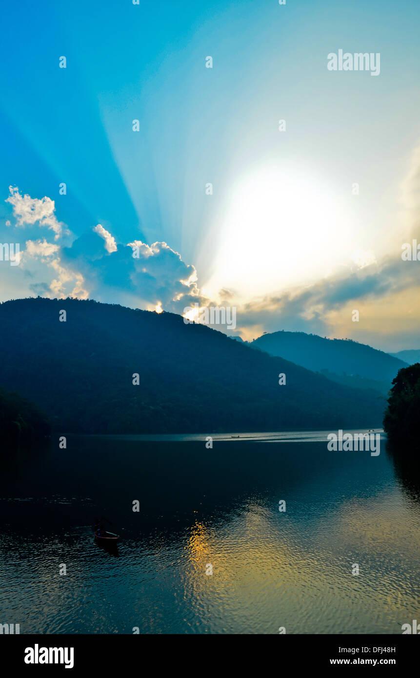 sunset at phewa lake in nepal - Stock Image